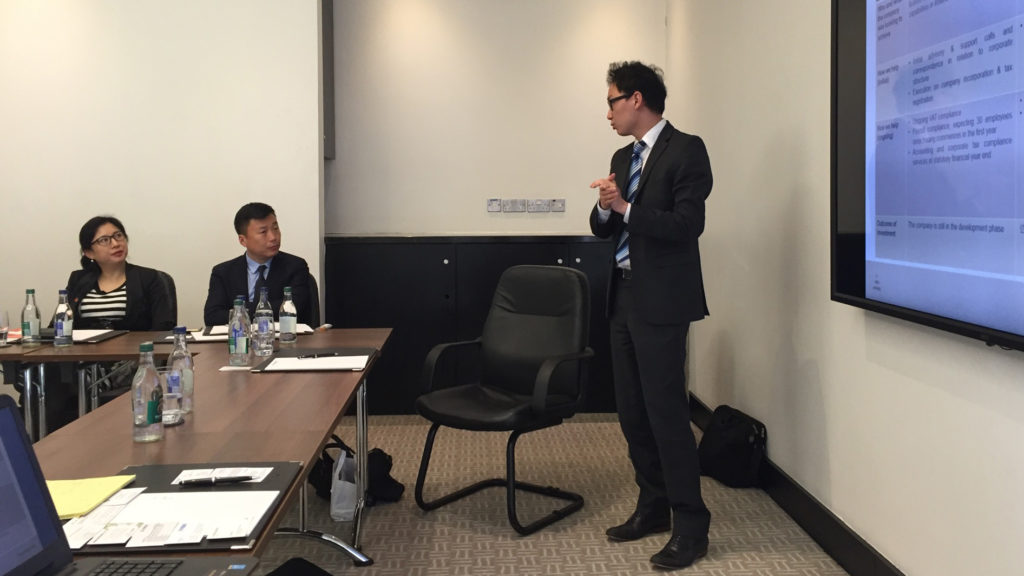 Hao Wang presenting to a Chinese delegation